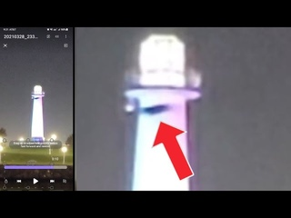 Black UFO passing by the tower on Long Beach Ca