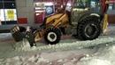 Экскаватор-погрузчик CASE-570ST на уборке снега