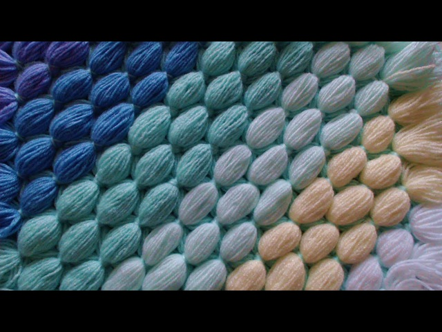 Pom pom blanket. Diagonal blanket from scrap yarn.
