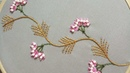 Hand embroidery design of a creeper plant with pistil stitch and plastic pearls