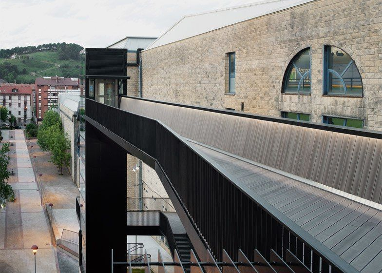 Glass elevator and steel bridge by Vaumm connect two neighbourhoods in a Spanish town