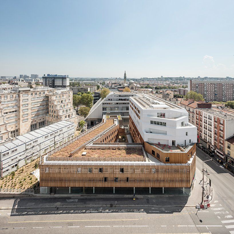 AAVP uses larchwood slats and aluminium sheets to clad student residence in Paris