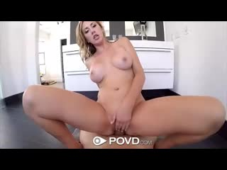 Curvy blonde milf brett rossi is looking at the camera while rubbing a huge cock against her tits